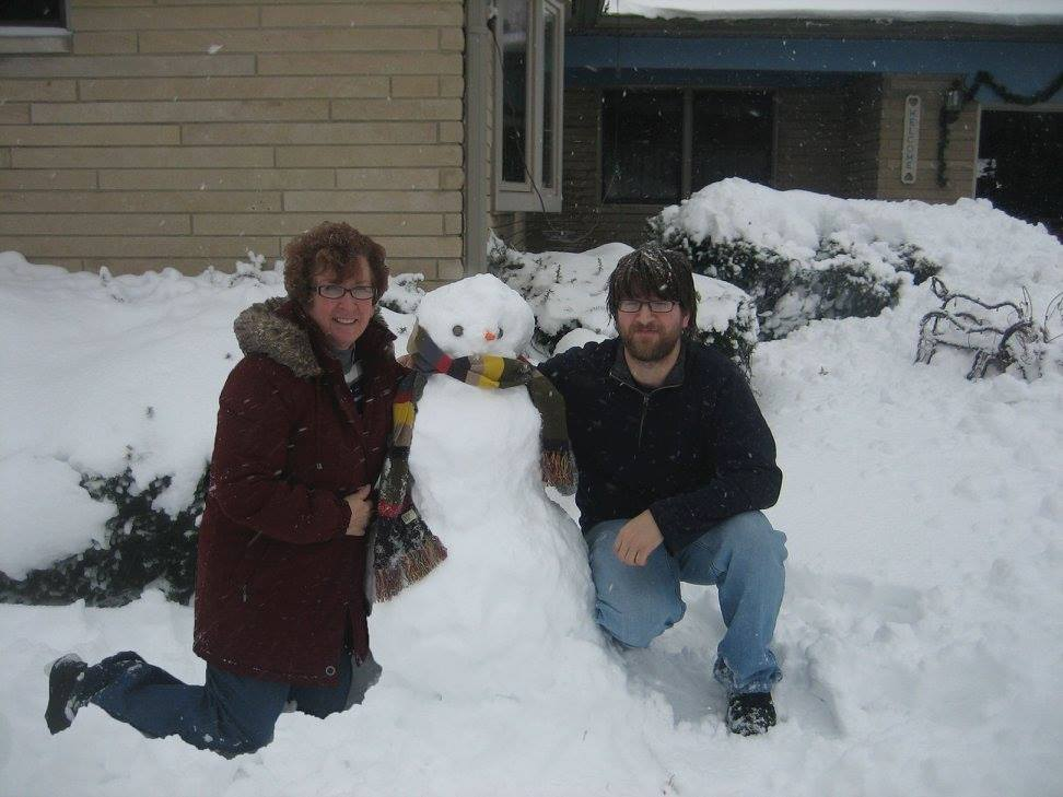 Woman, Snowman, and boy