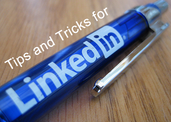 "The title image that reads: ""Tips and Tricks for LinkedIn"" which displays a blue pen on a wooden table top."